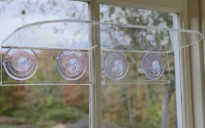 clear suction cup shelves attached to window