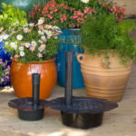 Plastic pot conversion kit shown with other potted plants growing in the background