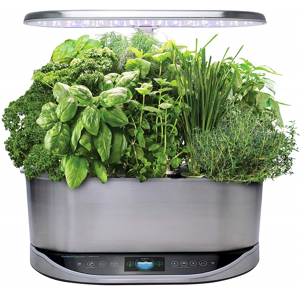 AeroGarden Bounty Elite filled with basil chives thyme and parsley