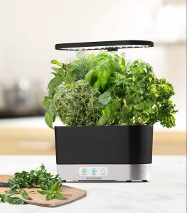 AG Harvest with fresh herbs on a cutting board
