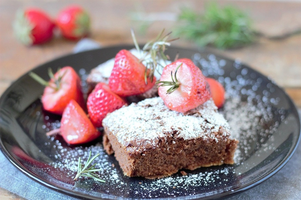 Chocolate cake flavored and garnished with rosemary and strawberries