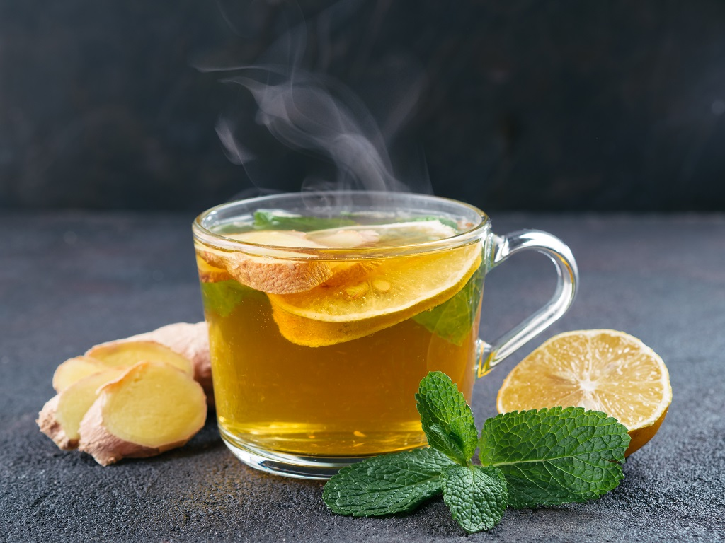 sprigs of mint with ginger, lemon and tea