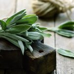bundle of sage on a cutting board getting ready for cooking