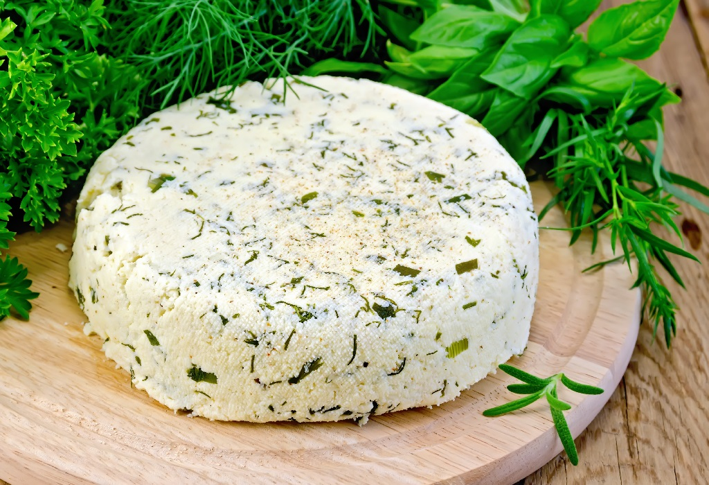 soft cheese made with basil, parsley and rosemary