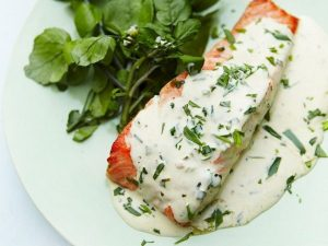 tarragon salmon on a white plate