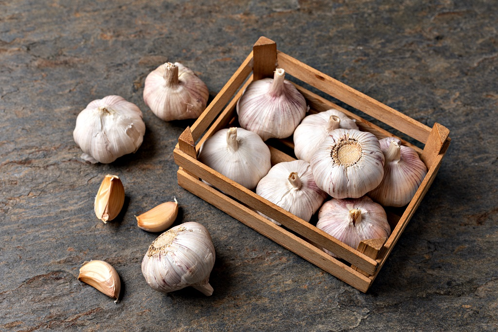 wooden box of garlic bulbs
