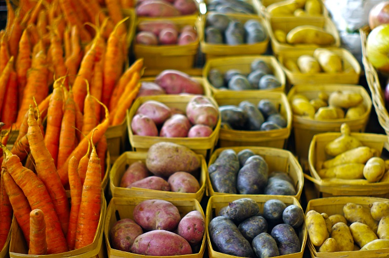 carrots with red purple and yellow potatoes