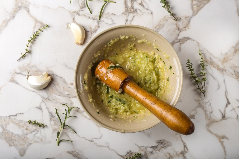 garlic sauce in bolw with herbs