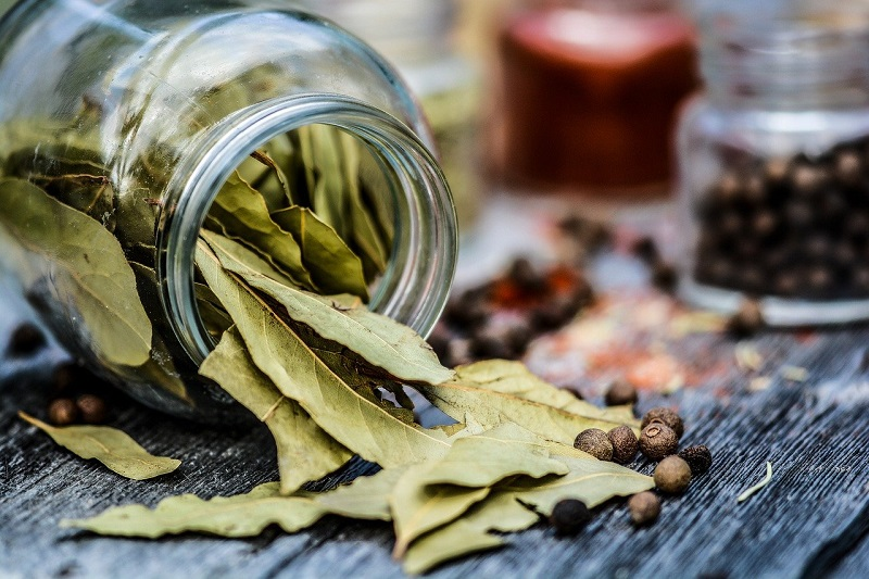 dried bay leaves in a ball glass jar