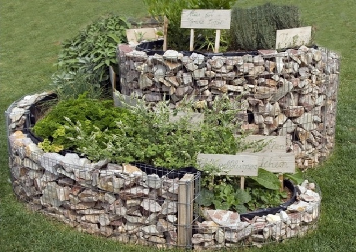 the herb spiral created with rocks as the foundation walls